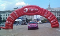 "Advertising arch for ""Total"""